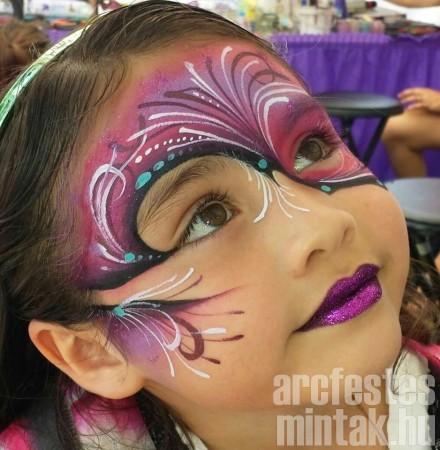 Kislány arcfestés csillámmal, művész: Mark Reid